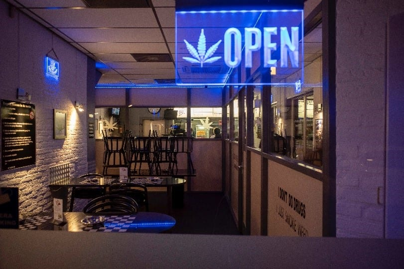 A picture containing indoor sign for cannabis dispensary